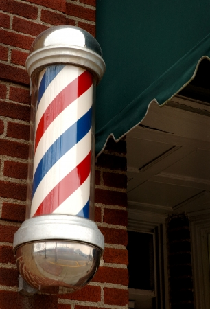 barber: Small Town Barber Pole Stock Photo