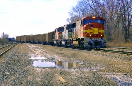freight transportation: Colorful Locos Pulling Coal Train Stock Photo