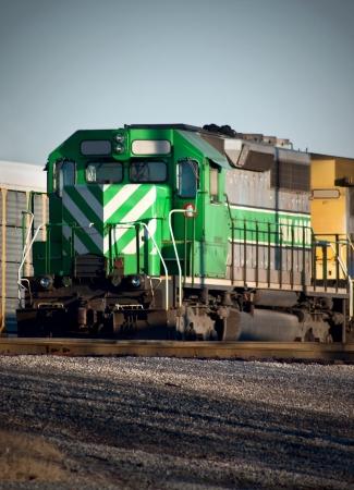 Green Locomotive departing Yard Stock Photo