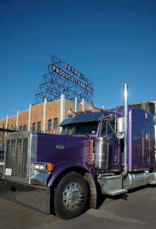 Purple Produce Semi Truck at Terminal