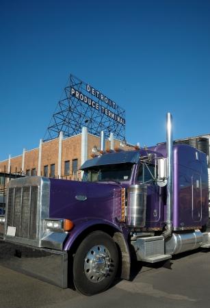 Purple Produce Semi Truck at Terminal