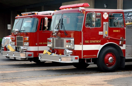 fire truck: Fire trucks parked outside of station