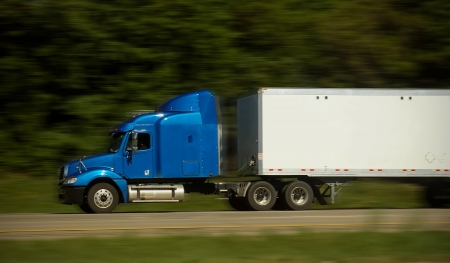 Fast Blue Truck on Freeway Stock Photo