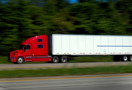 Fast Red Truck on Freeway