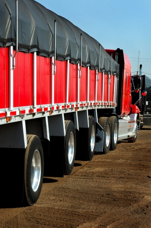 truckload: Red Truck and Trailer Steel Hauler