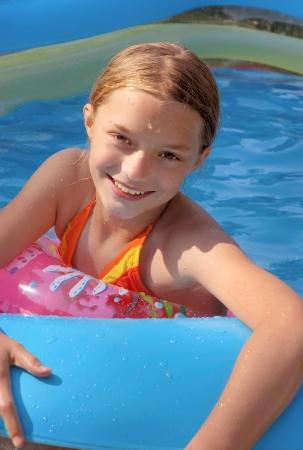 Girl in Backyard Pool in Summer