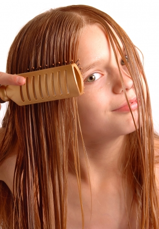 haircare: Girl with Wet Clean Hair Combing