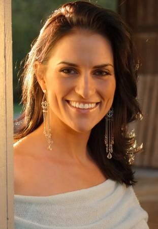 Smiling Italian Woman Outdoors Banco de Imagens