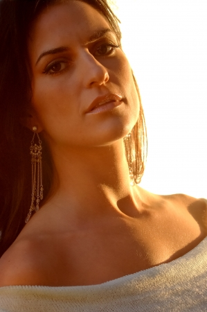 Sunlit Italian Woman Outdoors Banco de Imagens