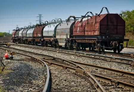 boxcar train: Steel Coil Railroad Cars Stock Photo
