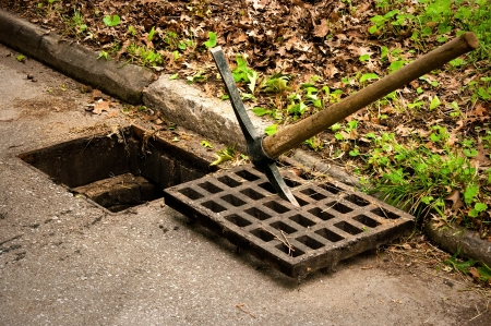 Storm Drain Cleaning Cover off Stock Photo