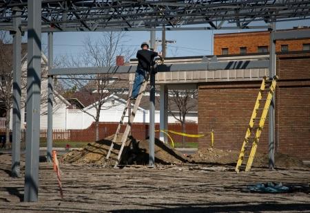 improvment: Worker on Construction Frame