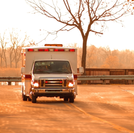 EMS truck in route to hospital at dawn
