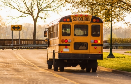school bus: School bus in route to collect students Stock Photo