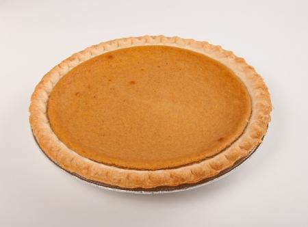 Pumpkin pie with autumn fresh on table