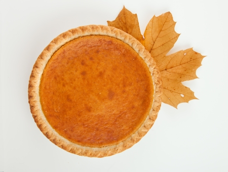 Pumpkin pie with autumn leaves decor