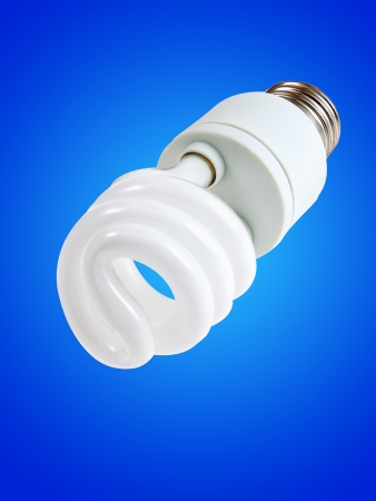 iluminate: New style light bulb glowing on blue