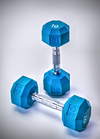 dumb bells: Blue dumb bells and fit exercise tools