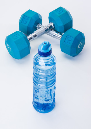 free weights: Blue dumb bells and fit exercise tools