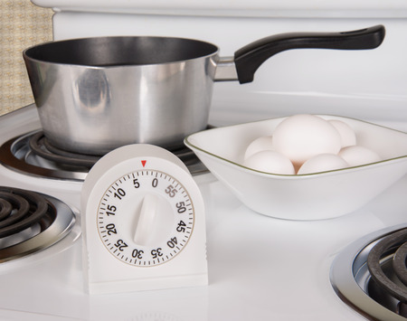 boiling: Kitchen tools for boiling eggs on stove Stock Photo
