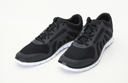 New black sports shoes on white background Stok Fotoğraf