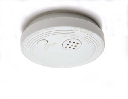 Smoke detector with alarm for fire safety Stock Photo