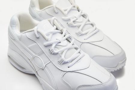 White athletic shoes on white background Фото со стока