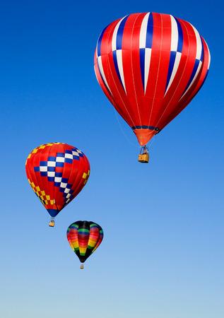 red hot air balloon ride under blue sky