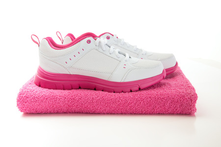 pink running shoes after workout sweaty towel