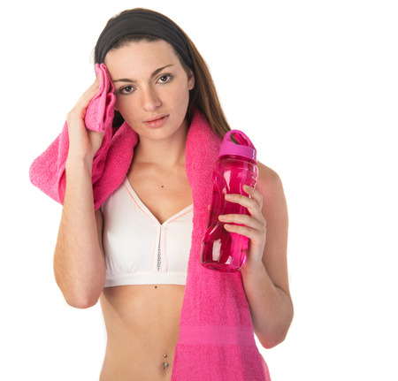 fitness girl with towel and water bottle Stock Photo
