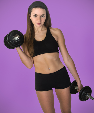 dumb bells: Fitness female using weights for training results Stock Photo