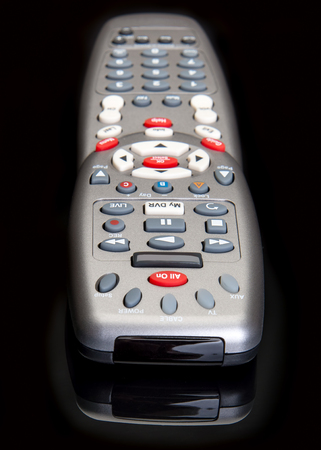 Remote control for hands on movie and sports programming Stok Fotoğraf