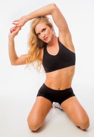 Fitness model posing in workout outfit Stock Photo