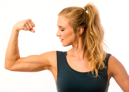 flexed: Fitness model posing proudly with arm muscle flexed
