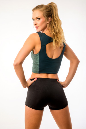 Fitness model posing in workout outfit Stok Fotoğraf