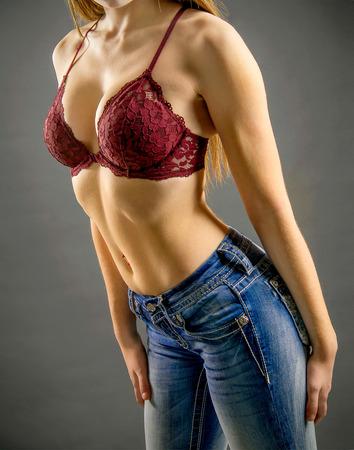 Fashion model wearing fitness revealing body parts Stock Photo
