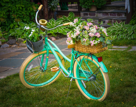 Old Green bike as yard decor piece Stock Photo