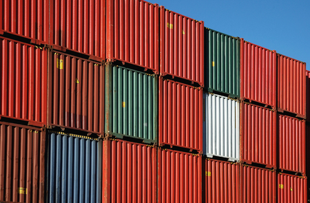 Stacks of shipping containers in port yard