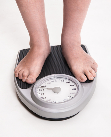 Checking results of diet and exercise on scale
