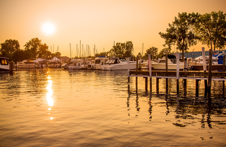 Golden glow on marina boats and water