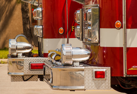Local fire department red engines on stand by Stock Photo