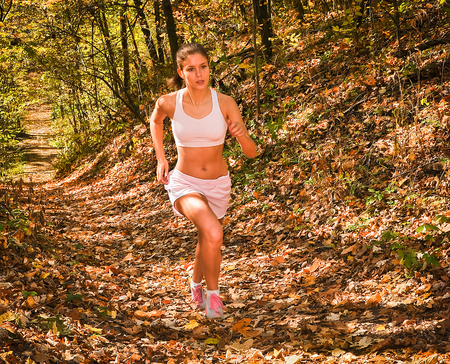 stair climber: Girl running in park woods on trail