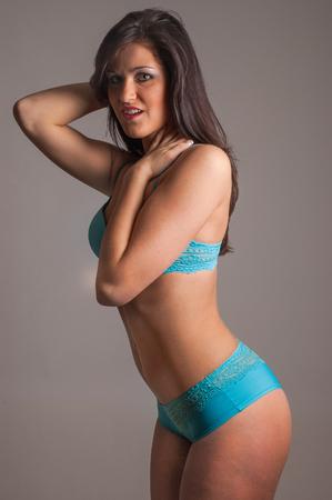 Fitness girl wearing sexy blue underwear
