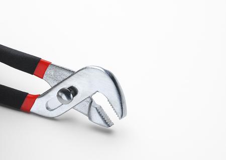 Channel lock adjustable pliers on white Banco de Imagens