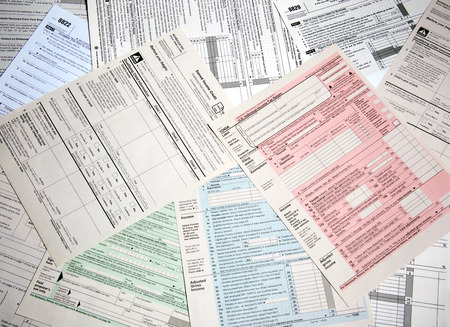 Variety of tax forms for filing calculations Stock Photo