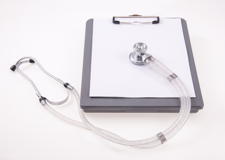 clip board and stethoscope for medical exam Stock Photo