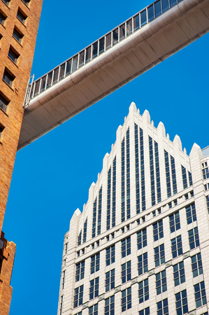 Towering buildings with sky walk connection Detroit