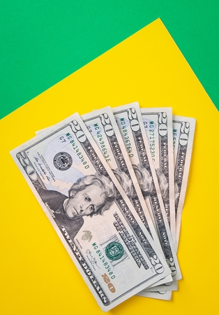 Money for bills or spending on colorful tabletop Stock Photo