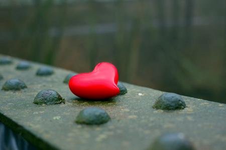 Red heart on a metal plate