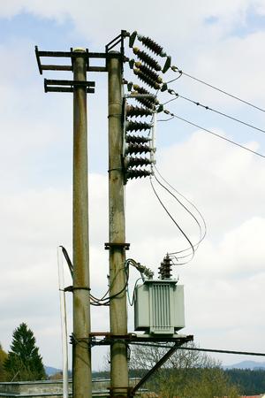 isolators: Transformer with column, ceramic isolators and sky Stock Photo